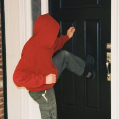 Burglar-Resistant Doors - Burglar kicking in door