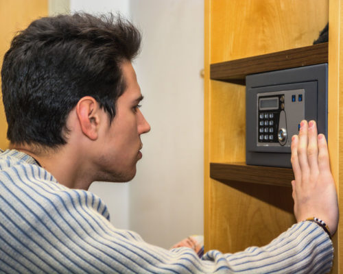 Man opening home safe