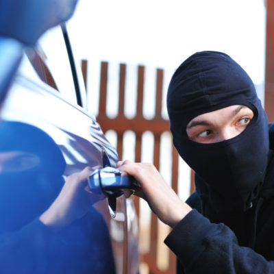 Masked man breaking into blue car | car security system | Lock N More 24/7 locksmith