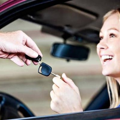 Find a Local Locksmith | Mobile Locksmith handing replacement car key to smiling customer | Lock N More