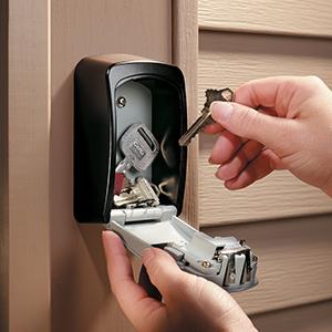 Open real estate lock box with keys inside