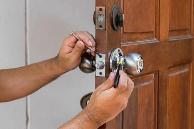 Locksmith repairing front door lock | Residential Lock Repair | Lock N More