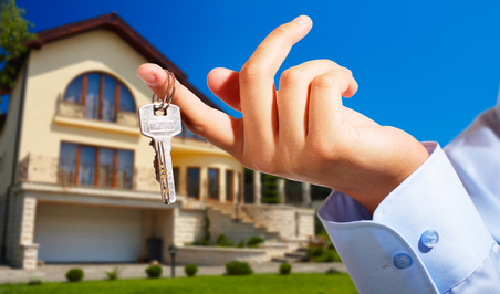 Person holding keys in front of home | Residential Locksmith | Lock N More