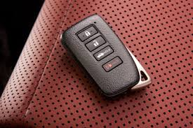 Smart key fob on perforated red leather seat | Lock N More