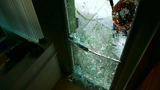 Retail Store Burglaries | Burglar breaking store door glass | Lock N More