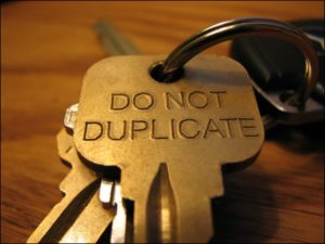 Do Not Duplicate Key on Keyring On Wood Table | Lock N More