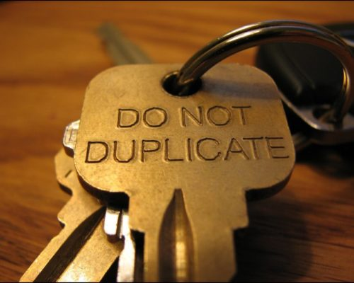 Do Not Duplicate Key on Keyring On Wood Table