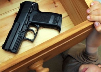 Gun Safety | Child reaching for gun in drawer at home | Lock N More